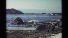 1982: waves rolling in over rocks CARMEL CALIFORNIA Stock Footage