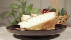 Gentle sponge cake with banana layer. Homemade festive dessert Stock Footage