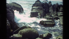 1982: waves crashing over rocks on beach CARMEL CALIFORNIA Stock Footage