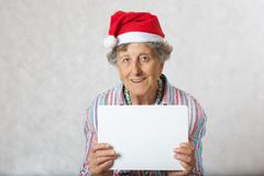 Old woman in the hat of a santa claus Stock Photos