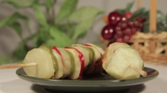 Baked potatoes with vegetables on skewers. The concept of vegetarian food Stock Footage