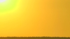 The hot fiery sun gradually growing dull slowly leaves for the horizon. Stock Footage