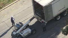 Forklift offloading a skid from a truck Stock Footage