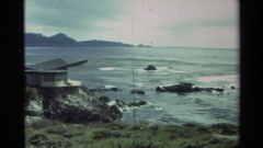 1982: a house on a rocky point jutting out into the sea CARMEL CALIFORNIA Stock Footage