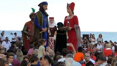 Giant King and Queen of Festa Major Dance By The Sea, Catalonia Spain Stock Footage