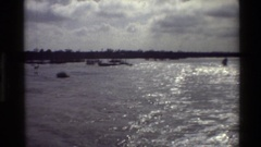 1982: ocean or large lake with boats, rocks and other indistinguishable objects Stock Footage