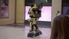 Bumblebee Transformer actor in costume walking toward Hollywood Boulevard LA Stock Footage