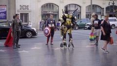Wolverine and Superman Captain America talking Transformer actors costumes LA Stock Footage