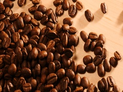 Coffee beans on wood desk Stock Footage