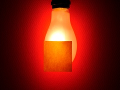 Gradualy bright light bulb for post it paper Stock Footage
