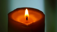 Orange candle closeup quiet Stock Footage