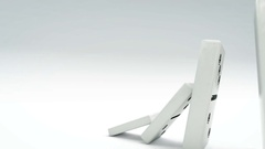 Domino effect from little to big. A chain of dominos of increasing size. Stock Footage