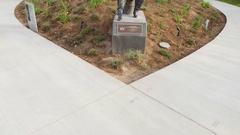 Bronze Sir John Falstaff statue with beverage Stock Footage