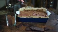 Making chocolate dessert. Preparing for baking cake. Man hand spread chocolate Stock Footage