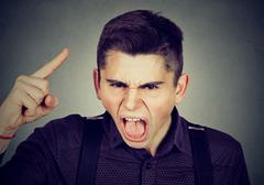 Portrait of an angry young man Stock Photos