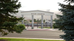 Eccles Coliseum entrance from between trees Stock Footage