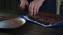 Chocolate brownie on plate. Chef serve chocolate dessert on plate Stock Footage
