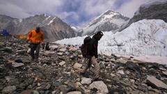 Walking trekkers in Everest base camp established on Khumbu Icefall. Himalaya Stock Footage
