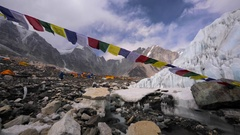 Prayer flags blowing on wind, Himalaya mountains,icy stream. Everest base camp Stock Footage