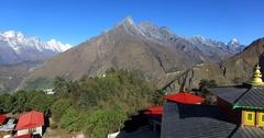 Flying backwards above Tengboche Monastery, Nepal. View of Kongde Ri mountain Stock Footage