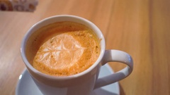 Adding sugar to cappuccino and stirring. Cup of coffee close up 4K shot Stock Footage