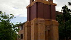 Southern Utah University campus bell tower with trees Stock Footage