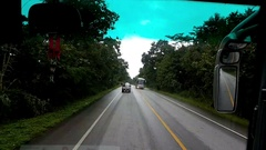 Driving a bus on a country road in Thailand in the evening, time lapse. Stock Footage