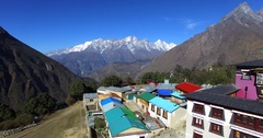 Flying above nepalese Tengboche Monastery.Himalaya mountains are on background Stock Footage