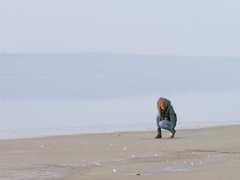 Beautiful girl paints the words and wrote in the sand on the beach. Stock Footage