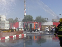 Firefighters from Zvulun spray water in burning factory, Akko – Israel Stock Footage