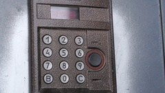 Person dialing number of apartment on a doorphone Stock Footage