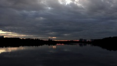 Sunset on the lake in clouds - Timelapse Stock Footage