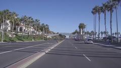Passing Under The Huntington Beach Pedestrian Bridge Along Pacific Coast Highway Stock Footage