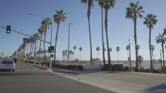 Driving along PCH in Huntington Beach, California Panning The Pier Stock Footage