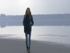 Young beautiful girl walking to camera and smiling in fog and mist. Back light Stock Footage
