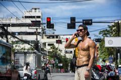 Muscular sportsman on Phuket street Stock Photos