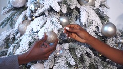 Afro couple hand's decorated Christmas tree Stock Footage