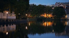 Beautiful pond in the Night. Cozy Town. Norway. Evening Stock Footage