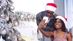 Smiling young african family in Christmas atmosphere making photo with Stock Footage