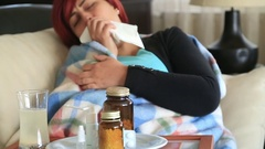 Woman at home sick with flu lying on bed  and resting 1 Stock Footage