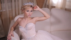 Beautiful young, sexy blonde woman, a princess with curly long hair model, bride Stock Footage