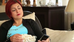 Woman with redhead watching tv at home Stock Footage