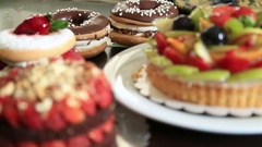 Delicious tart with fresh fruits cakes and donuts 6 Stock Footage