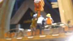 Worker untie wire sling between crane after moving object Stock Footage
