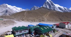 Flying above Gorakshep, a frozen lakebed covered with sand in Nepal. Himalaya Stock Footage