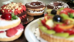 Delicious tart with fresh fruits cakes and donuts Stock Footage