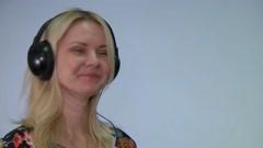 Teen girl in headphones singing into microphone Professional audio studio music Stock Footage