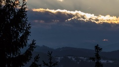 Sun rises over clouds and forest landscape winter time lapse. Dramatic morning. Stock Footage