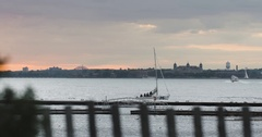 Sailboat passing on NYC's East River at sunet - 4k Stock Footage