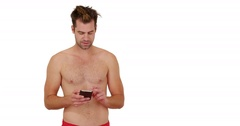 Happy man in swimsuit standing in front of white background with copy space Stock Footage